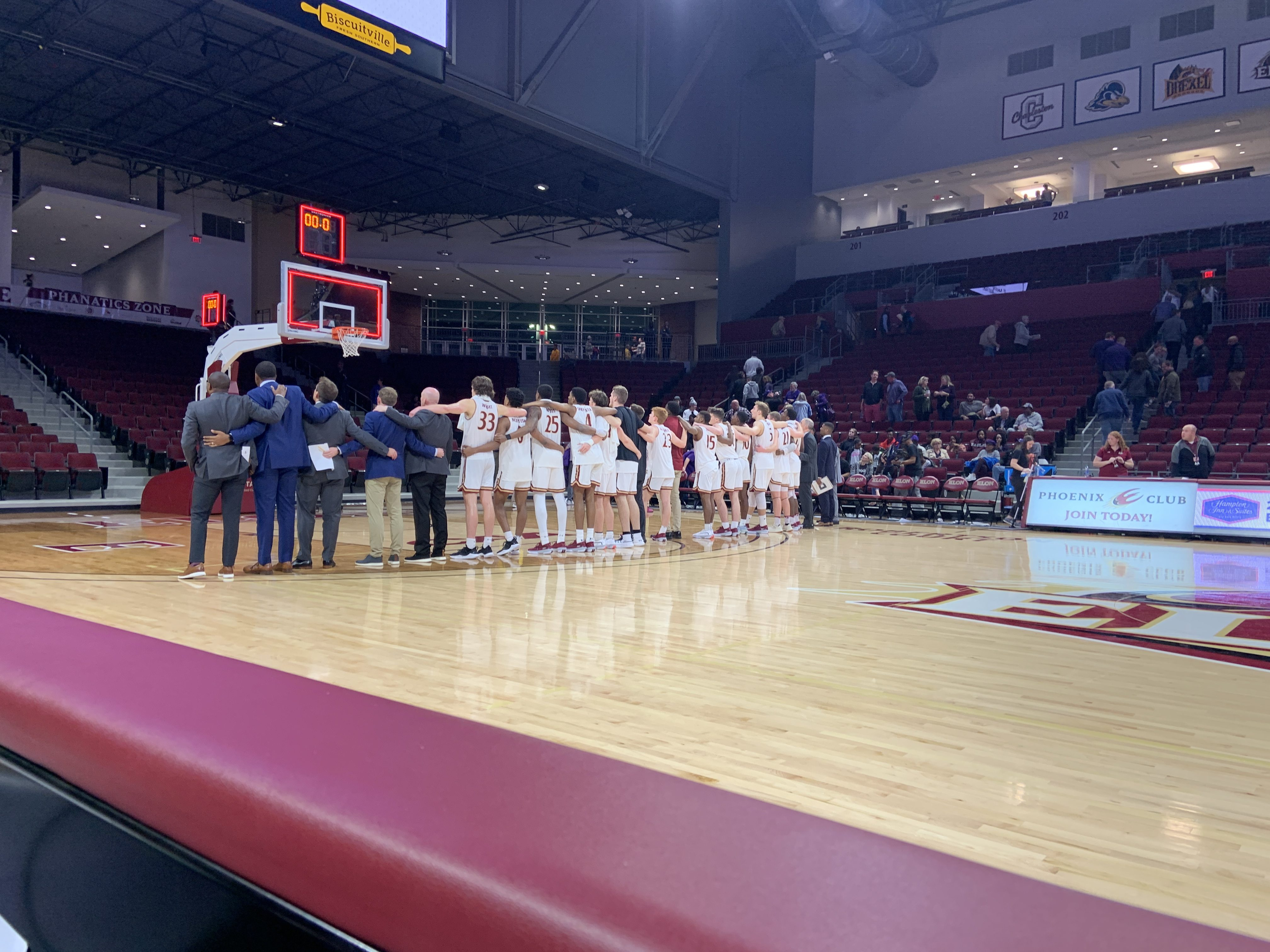 Elon Men's Basketball sings the fight song after a loss to Furman.